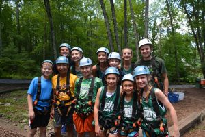 kids at summer camp about to use ropes course