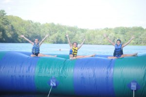 girls on the blob at camp